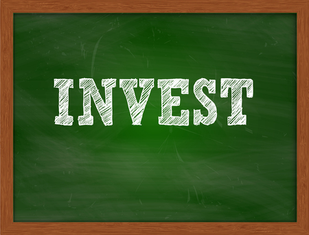 green chalkboard: INVEST handwritten chalk text on green chalkboard Stock Photo