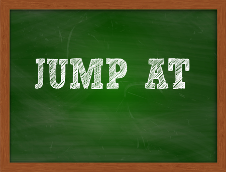 green chalkboard: JUMP AT handwritten chalk text on green chalkboard Stock Photo