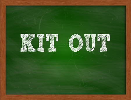 green chalkboard: KIT OUT handwritten chalk text on green chalkboard