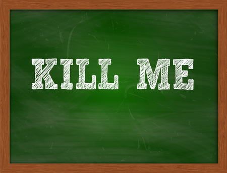 kill: KILL ME handwritten chalk text on green chalkboard Stock Photo