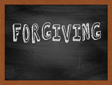 forgiving: FORGIVING  hand writing text on black chalkboard Stock Photo