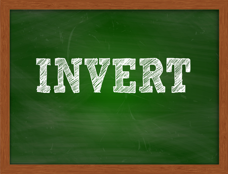 green chalkboard: INVERT handwritten chalk text on green chalkboard Stock Photo