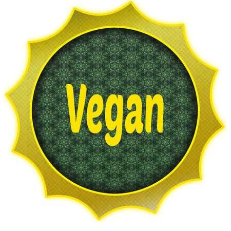 Golden badge with VEGAN text. Фото со стока