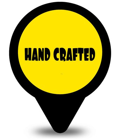 Yellow location pointer design with HAND CRAFTED text message Фото со стока