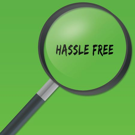HASSLE FREE text under a magnifying glass on green background. Illustration