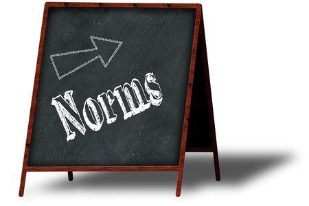 NORMS in chalk on wooden menu blackboard. Illustration concept