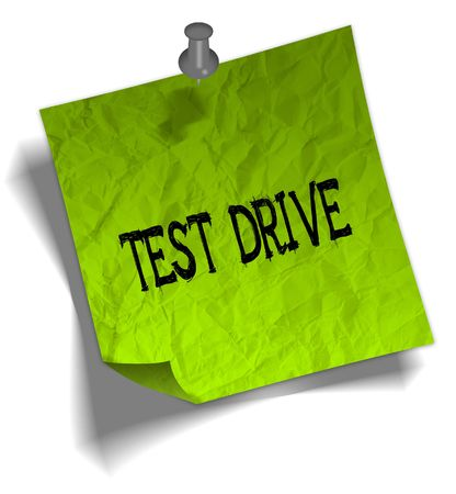 Green note paper with TEST DRIVE message and push pin graphic illustration. Stock Photo