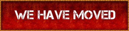 Distressed font text WE HAVE MOVED on red grunge board background. Illustration Stock Photo
