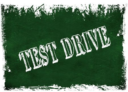 Green grunge chalkboard with TEST DRIVE text. Illustration graphic