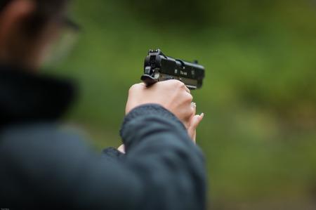 Woman holding a bb gun and tartgeting