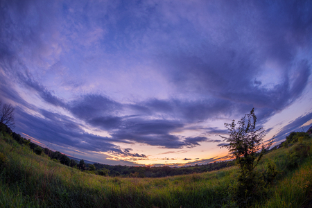Beautiful sunset after severe rain storm with dramatic clouds shot with fisheye ;ems 스톡 콘텐츠