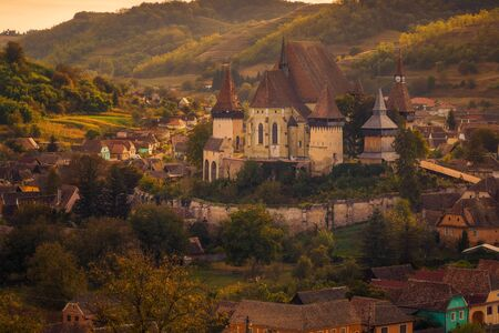Historical monument the fortified church of Biertan visited by tourists located in Romania with big walls surrounding the church