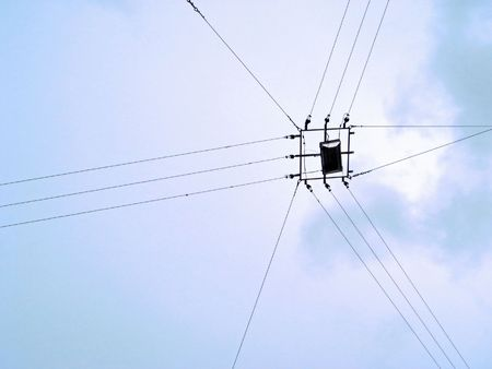 Street lamp hanging on cables over street Stock Photo