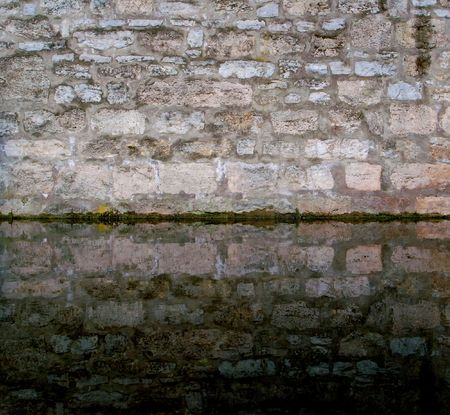 Brickwall and moat of an ancient castle