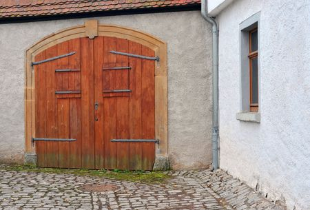 old wooden gate with windows in germany, europe photo