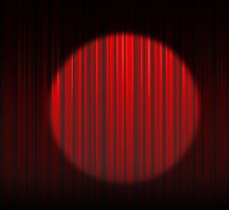 Illuminated red curtain with round spotlight