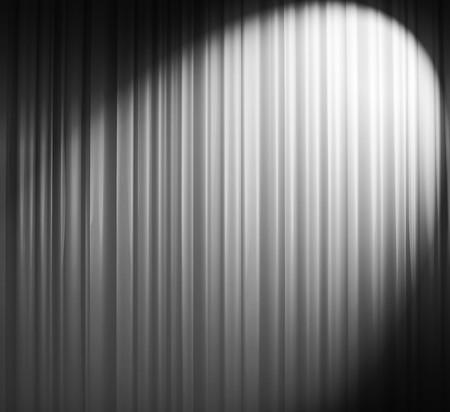Illuminated white curtain with round spotlight from upper right corner Stock Photo