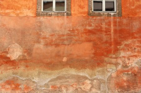 Part of grungy orange wall of an ancient building