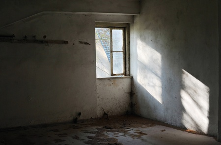 Old empty abandoned room with sunlight shining through the window photo