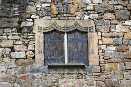 Part of an ancient wall of a medieval castle with window