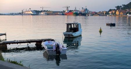 Two boats in the mediterranean harbour of mali losinj, croatia