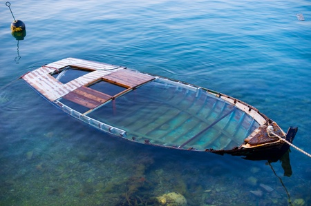 insolvency: Wreck of a wooden boat agrounded in the harbour