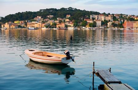 Boat in the mediterranean harbour of mali losinj, croatia Stock Photo