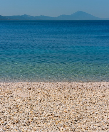 Beach of the adriatic sea with mountains of croatia in the background