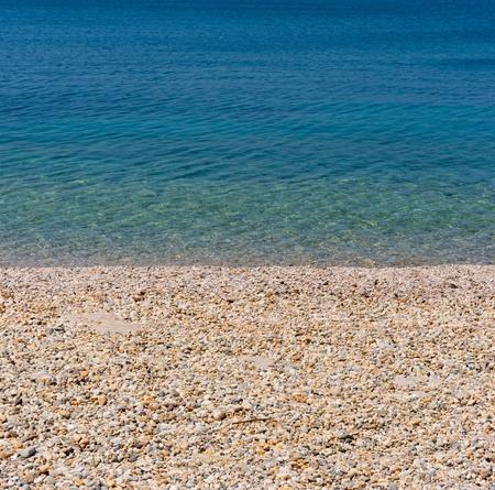 Beach of the adriatic sea with pebble stones