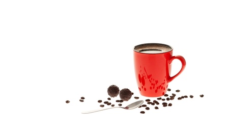 Red cup of coffee, coffee beans, chocolate and spoon isolated on white background Stock Photo