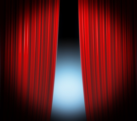 Illuminated red curtain closing on black background with softly fading spotlight photo