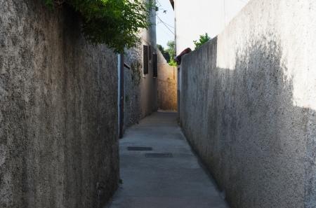 small mediterranen street with sunlight at the walls
