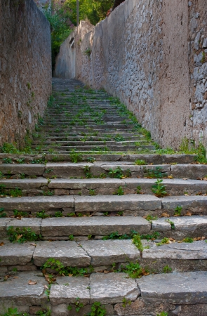 Ancient stairs of a walkway outside in a mediterranean village Stock Photo