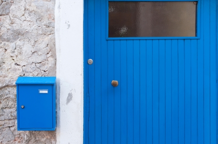Detail of a blue mediterranean door with letterbox