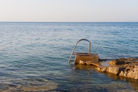 Stair for taking a bath in the rocky mediterranean sea in croatia