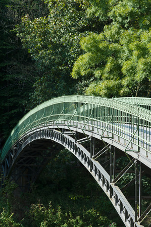 Steel section arched bridge over river Werra in the palace garden