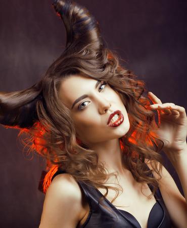 bright mysterious woman with horn hair, halloween celebration Standard-Bild