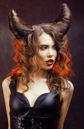 bright mysterious woman with horn hair, halloween celebration Zdjęcie Seryjne