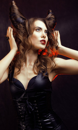 bright mysterious woman with horn hair, halloween celebration photo