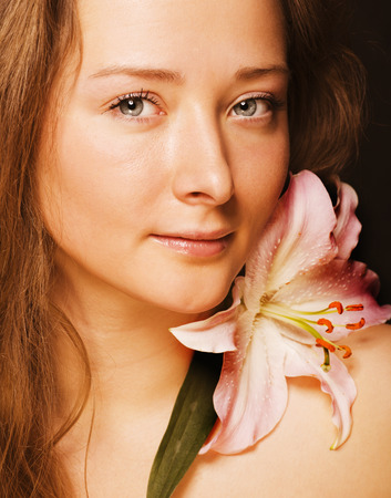 beauty young woman with flower getting spa photo