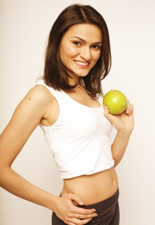 young girl with green apple in studio isolated photo