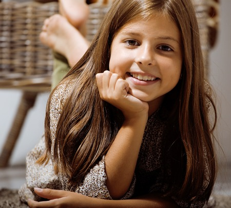 7 9 years: little cute brunette girl at home smiling close up Stock Photo