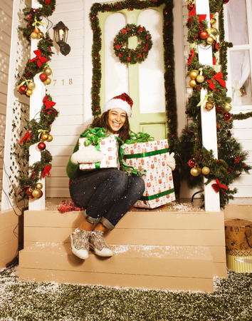 home decorate: happy young girl at home decorated on Christmas smiling