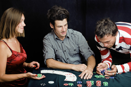young people playing poker photo