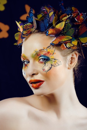 woman with summer creative make up like fairy butterfly closeup photo