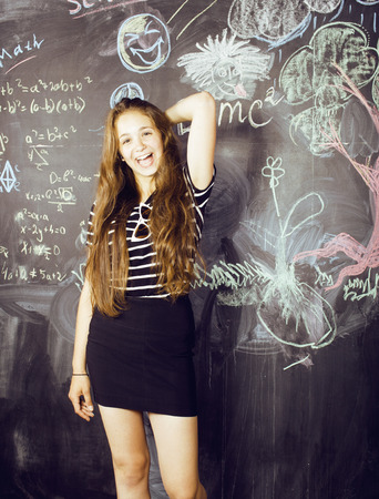 back to school after summer vacations, cute teen real girl in classroom photo