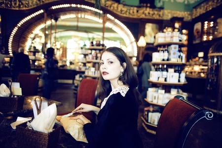 cofe: young elegant brunette woman in cafe drinking cofe, fashion style