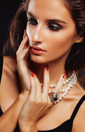 beauty young sencual woman with jewellery close up, luxury portrait of rich real girl, party makeup photo