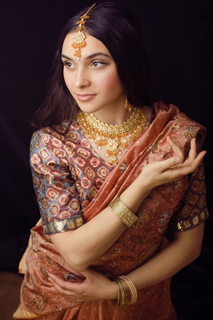 nude bride: beauty sweet real indian girl in sari smiling on black background Stock Photo