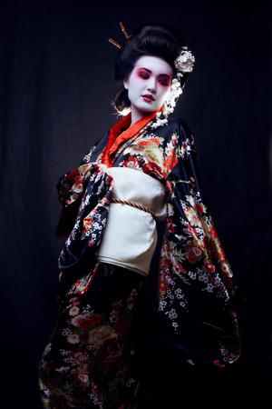 geisha kimono: Young beautiful asian womans portrait, geisha in kimono on black, oriental style